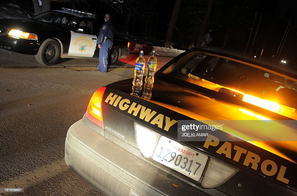 California Highway Patrol officers confer at a roadblock on Highway 38 near Angeles Oaks during a standoff with fugitive ex-cop Christopher Dorner, near San Bernardino, California on February 12, 2013. Nobody has yet been found in a burnt-out US mountain cabin where Dorner was believed to have barricaded himself after a six-day manhunt, a police spokesman said. Media reports that a body had been found in the cabin near Big Bear, east of Los Angeles, and identified as Dorner's were false, said Los Angeles Police Department (LAPD) spokesman Andrew Smith.