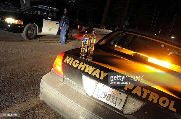 California Highway Patrol officers confer at a roadblock on Highway 38 near Angeles Oaks during a standoff with fugitive excop Christopher Dorner...