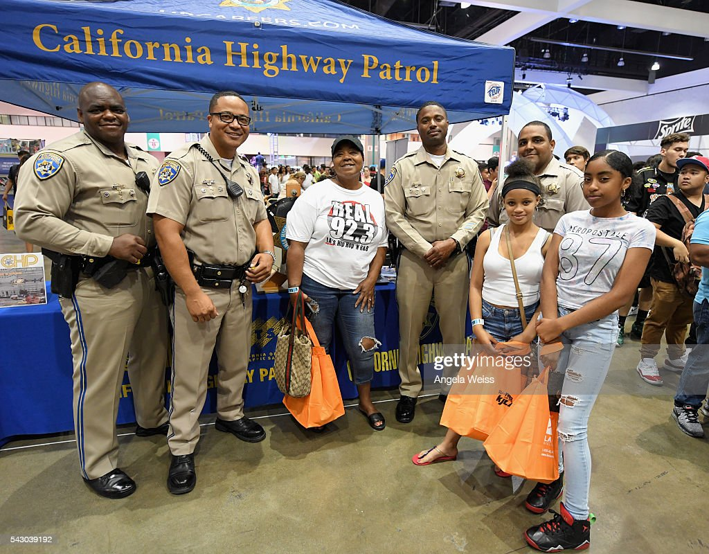California Highway Patrol officers greet guests at FAN FEST during the 2016 BET Experience on June 25, 2016 in Los Angeles, California.
