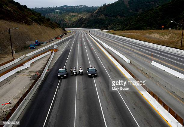 California Highway Patrol Officers meet about half way up the Sepulveda Pass on the empty 405 San Diego Freeway as the bridge demolition closure...