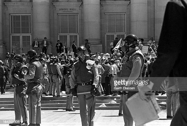 California Highway Patrolmen in helmets and gas masks take up positions as students and activists assemble in Spoul Plaza on the campus of the...