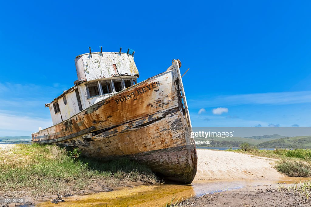 USA, California, Inverness, Tomales Bay with ship wreck