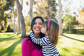 USA, California, Irvine, Portrait of smiling mother and daughter (4-5) kissing her