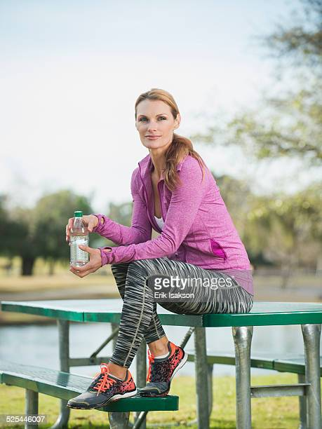 USA, California, Irvine, Portrait of woman is sports clothing in park