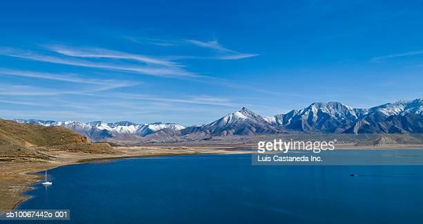 USA, California, Kern County, Lake Isabella and snowcapped mountains