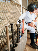 USA, California, Ladera Ranch, Boys (10-11) from little league sitting on dugout