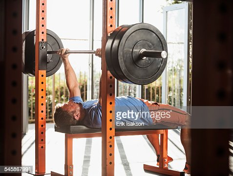 USA, California, Ladera Ranch, Mature man bench pressing : Stock Photo