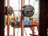 USA, California, Ladera Ranch, Mature man bench pressing