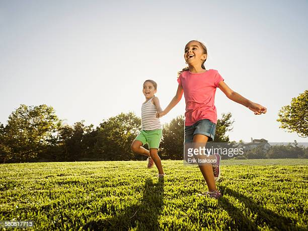 USA, California, Ladera Ranch, Sisters (6-7, 8-9) playing in park