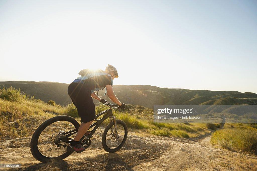 USA, California, Laguna Beach, Mountain biker riding downhill