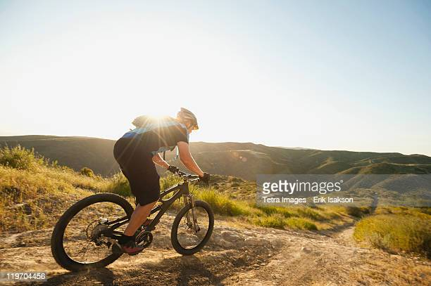 USA, California, Laguna Beach, Mountain biker riding downhill