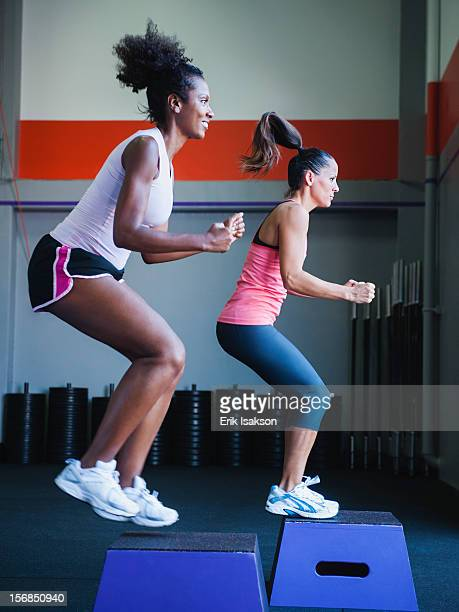 USA, California, Laguna Niguel, two women in step aerobics class