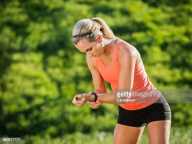 USA, California, Laguna Niguel, Woman looking at watch