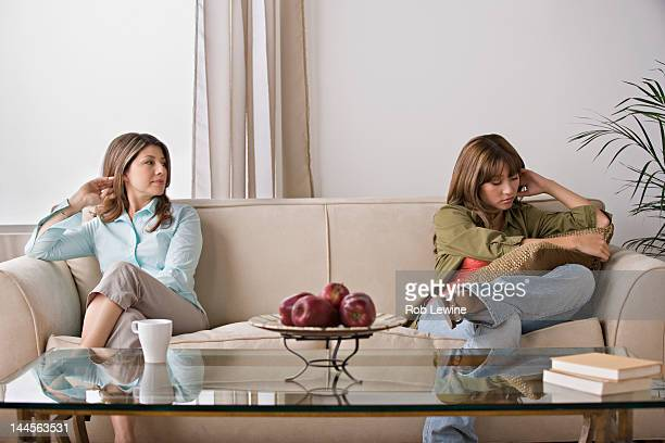 USA, California, Los Angeles, Angry daughter sitting with mother on sofa