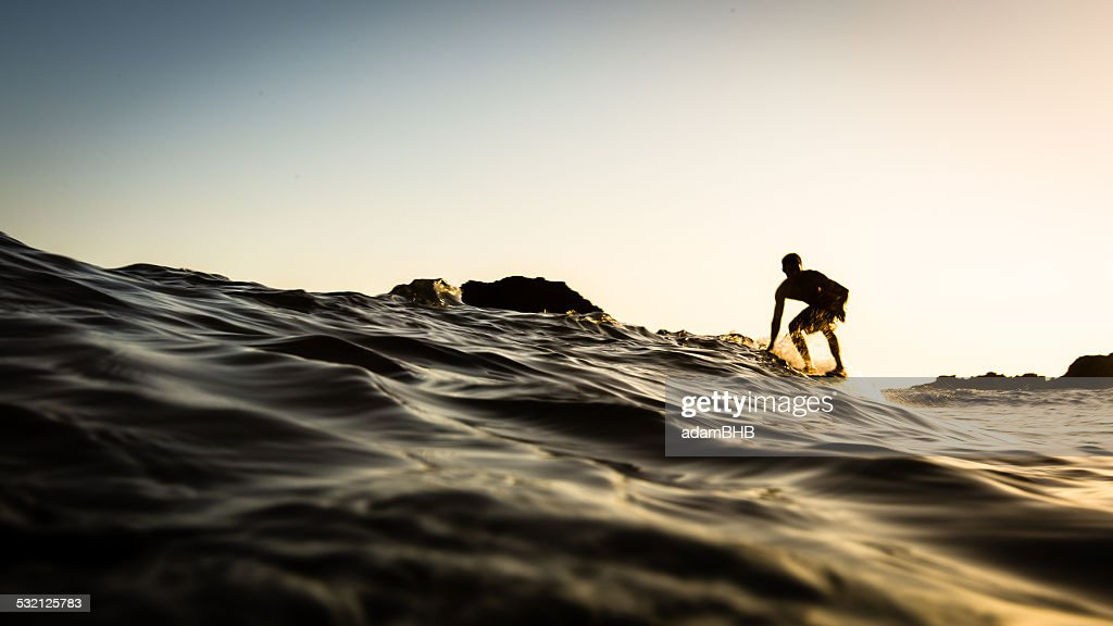 USA, California, Los Angeles County, Malibu, Surfer at sunset