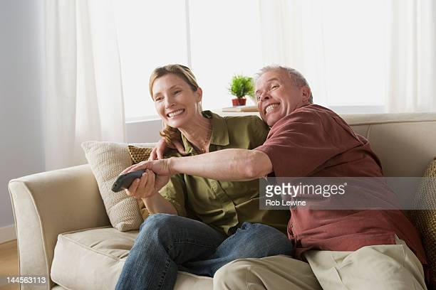 USA, California, Los Angeles, Couple fighting for tv remote