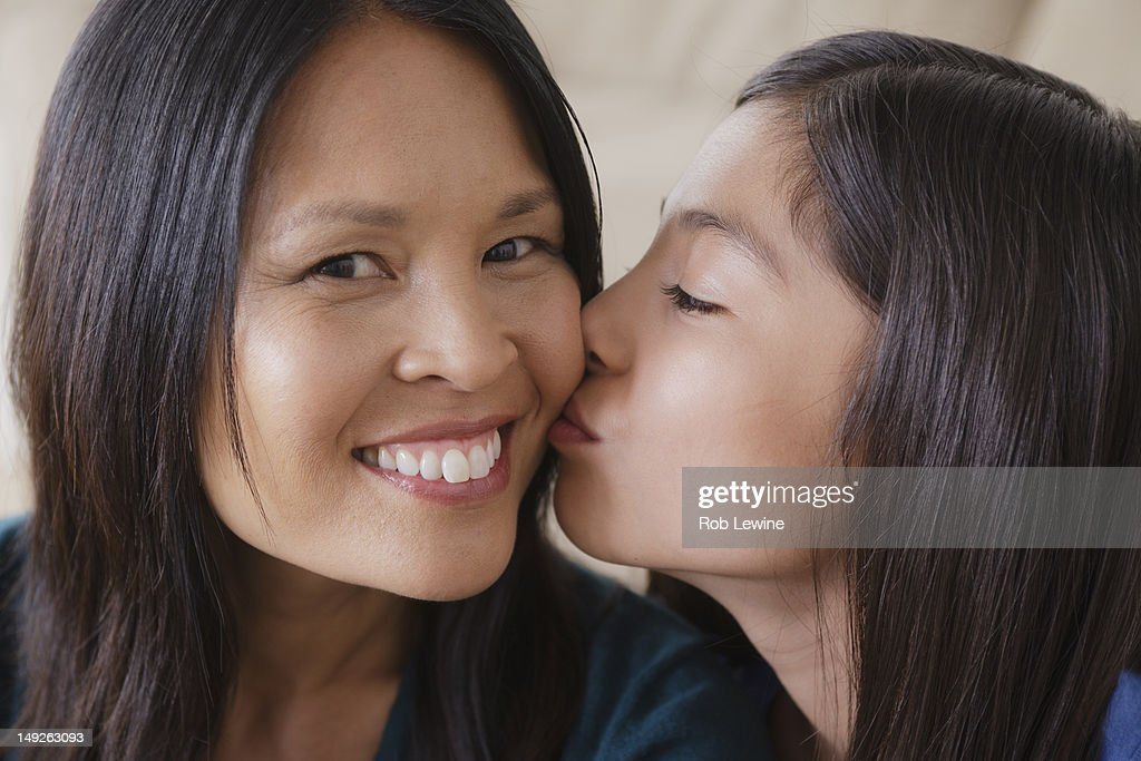 USA, California, Los Angeles, Daughter giving mother kiss on cheek : Stock Photo