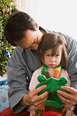 USA, California, Los Angeles, Father and daughter at Christmas tree