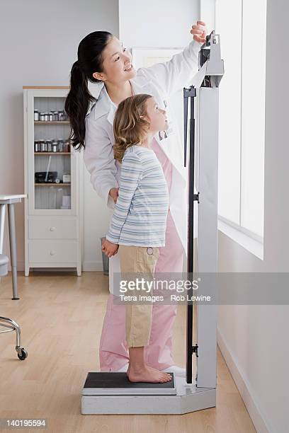 Girl Scales Stock Photos And Pictures