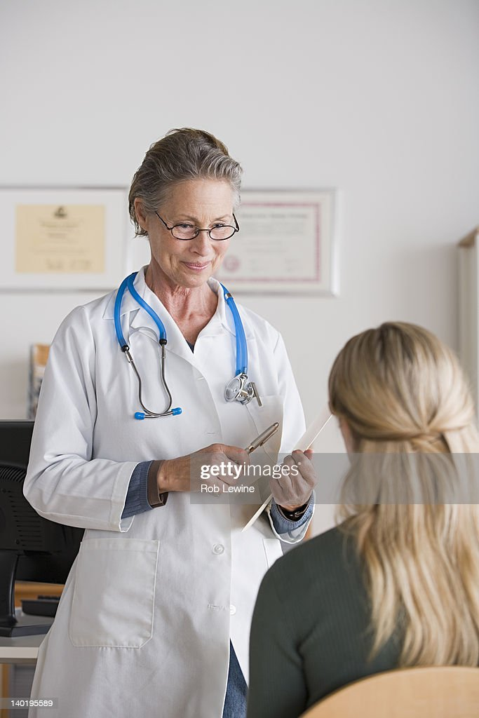 USA, California, Los Angeles, Female doctor talking to patient in her office : Stock Photo