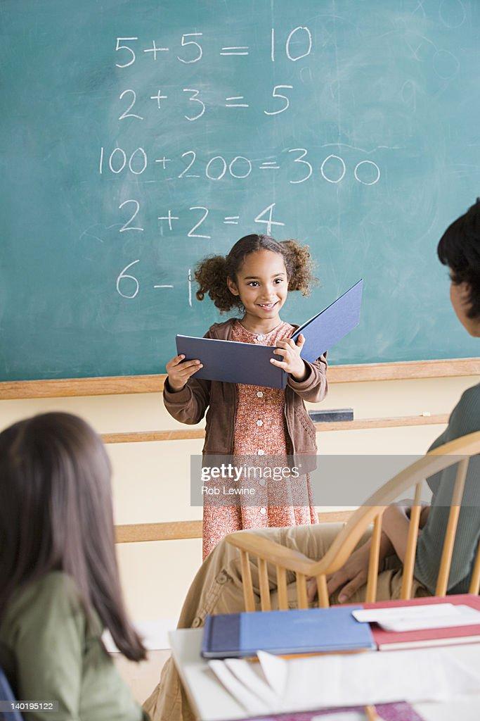 USA, California, Los Angeles, Girl (6-7) having presentation in classroom