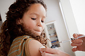 USA, California, Los Angeles, Girl (8-9) having vaccination