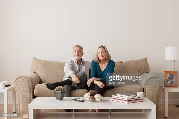 USA, California, Los Angeles, Happy senior couple sitting on sofa