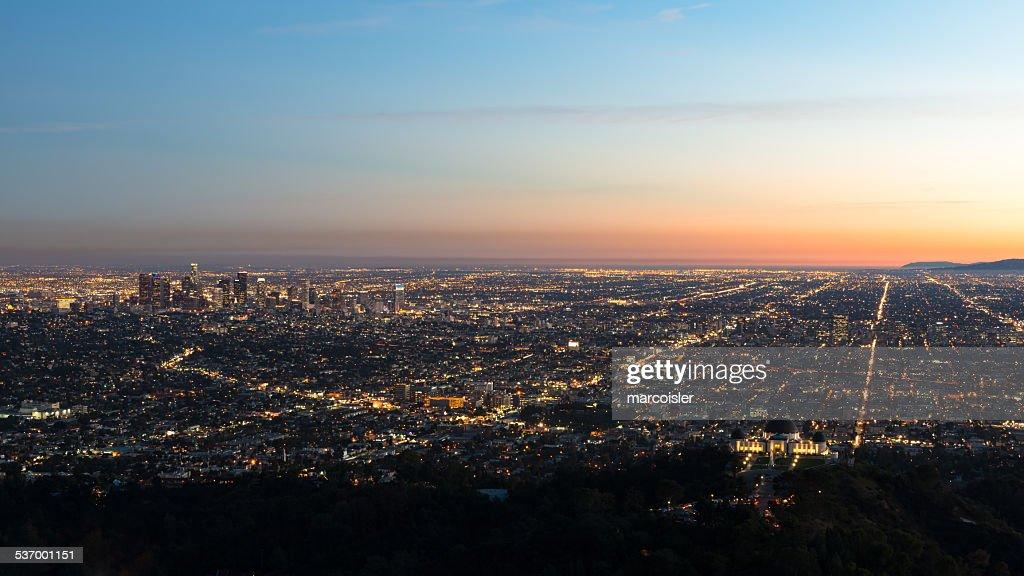 USA, California, Los Angeles, Illuminated cityscape at sunrise
