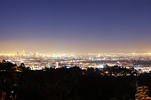 USA, California, Los Angeles, Los Angeles skyline at night, Hollywood in foreground