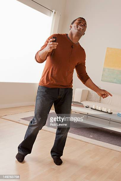 USA, California, Los Angeles, Mid adult man dancing at home