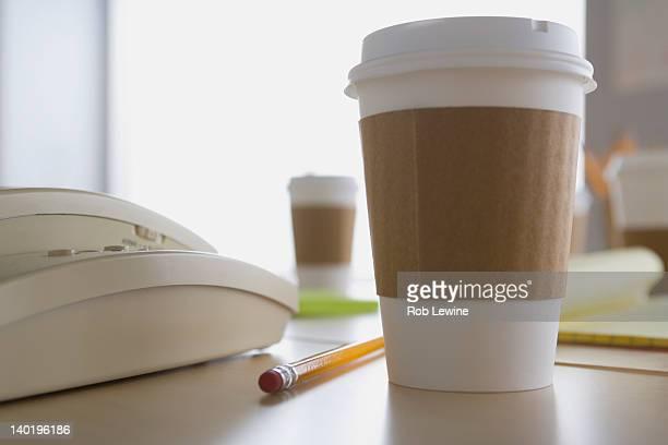 USA, California, Los Angeles, Plastic coffee cup on desk