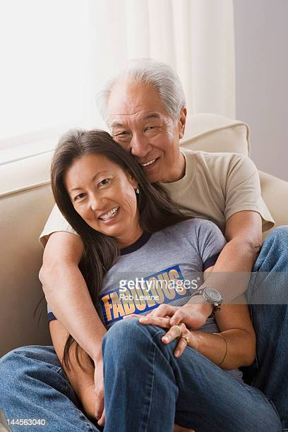 USA, California, Los Angeles, Portrait of couple relaxing on sofa