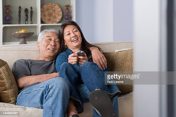 USA, California, Los Angeles, Portrait of couple watching tv