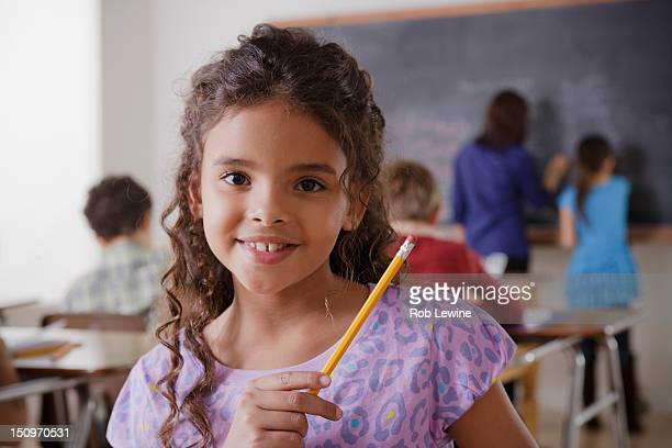 USA, California, Los Angeles, Portrait of schoolgirl in classroom