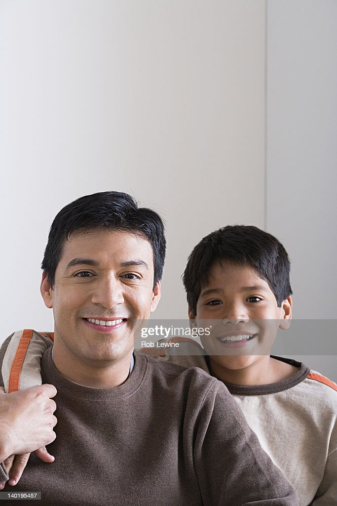 USA, California, Los Angeles, Portrait of smiling father and son (10-11) : Stock Photo
