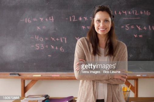 USA, California, Los Angeles, portrait of teacher with blackboard in background