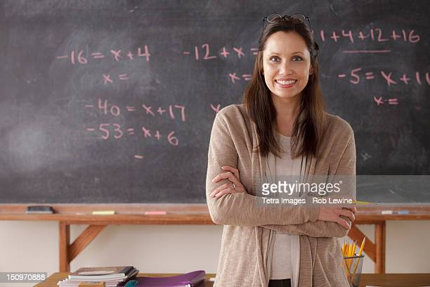 USA, California, Los Angeles, portrait of teacher with blackboard in background