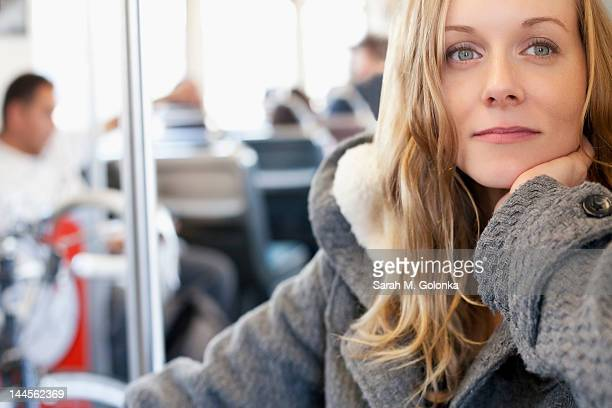 USA, California, Los Angeles, Portrait of woman in subway train