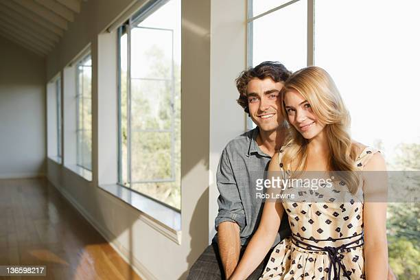 USA, California, Los Angeles, Portrait of young couple in empty home