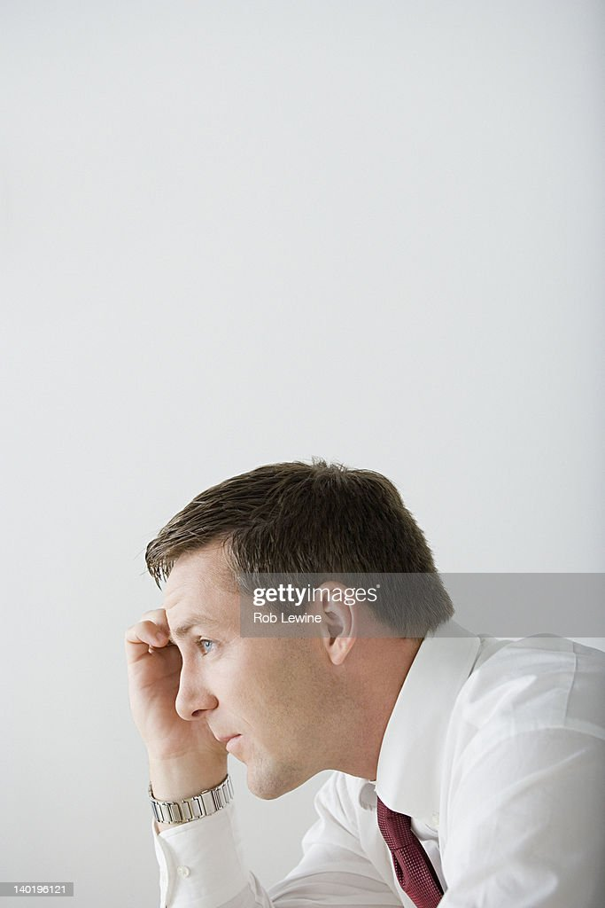 USA, California, Los Angeles, Profile of businessman contemplating : Stock Photo