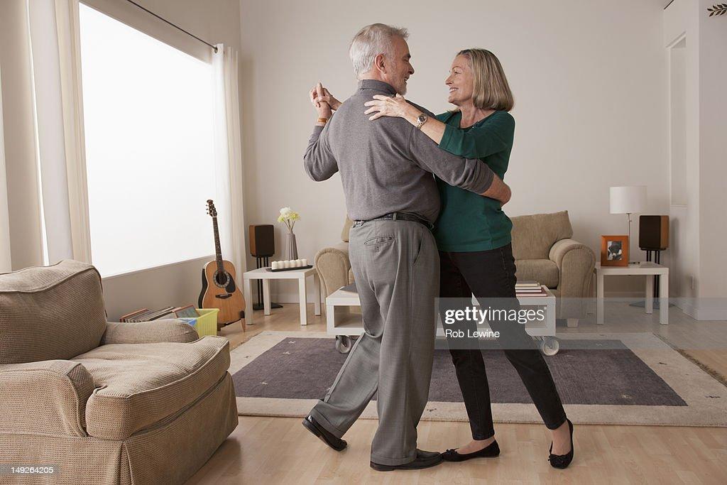 USA, California, Los Angeles, senior couple dancing at home