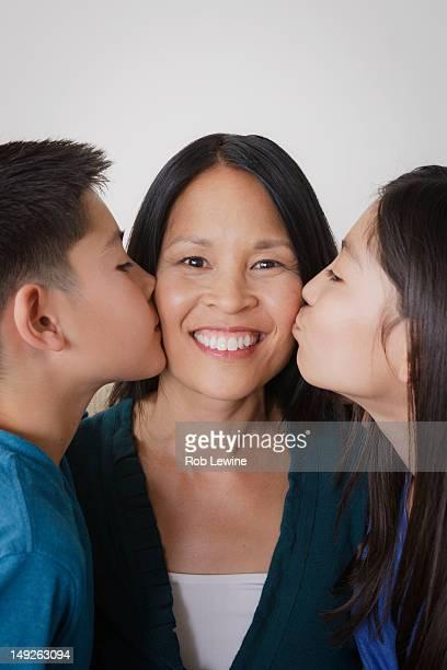 USA, California, Los Angeles, Siblings giving mother kiss