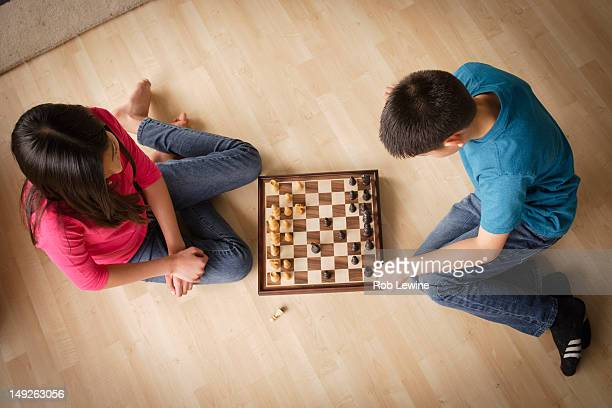 USA, California, Los Angeles, Siblings playing chess game