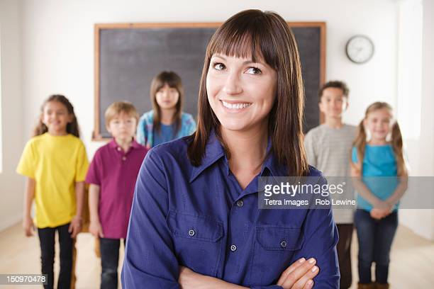 USA, California, Los Angeles, Teacher with group of pupils in front of blackboard