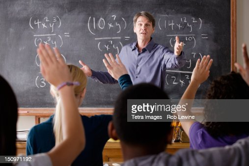 USA, California, Los Angeles, Teacher with teenage students (14-15,16-17) at school : Stock Photo