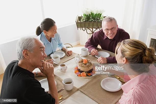 USA, California, Los Angeles, Two couples having coffee with cake