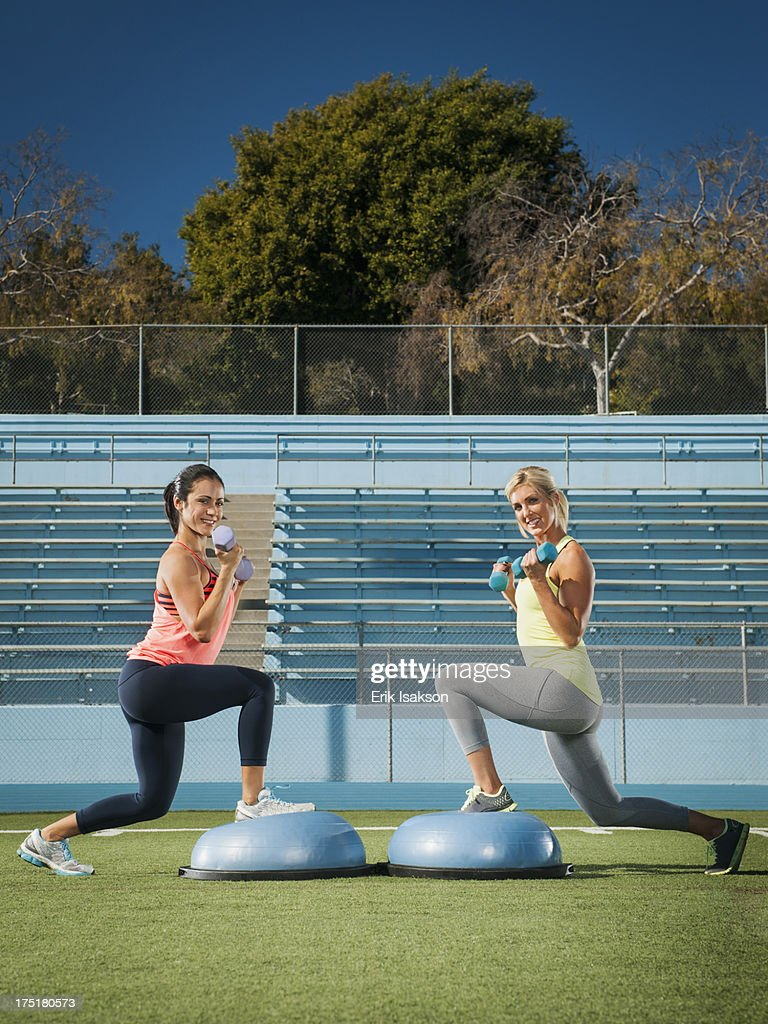 USA, California, Los Angeles, Two women exercising at sports field