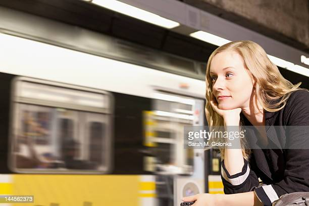 USA, California, Los Angeles, Woman sitting on subway station