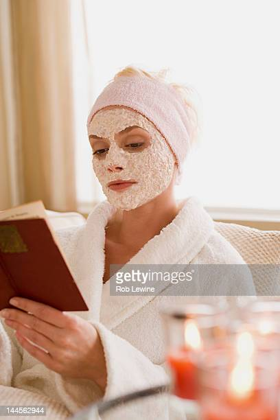 USA, California, Los Angeles, Woman with facial mask reading book