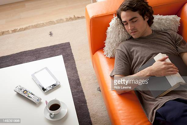 USA, California, Los Angeles, Young man sleeping on sofa
